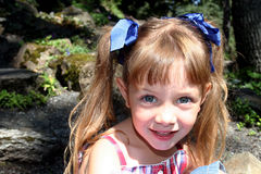 Cute girl with pigtails. A cute, young girl wearing pigtails with bows Stock Photo
