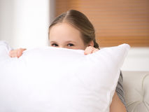 Cute girl with pillow. Royalty Free Stock Image