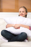 Cute girl with pillow. Royalty Free Stock Photography