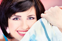 Cute girl on pillow. Cute smiling short hair girl on pillow Stock Images