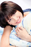 Cute girl on pillow. Cute smiling short hair girl on pillow Stock Photos