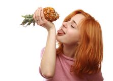 Cute girl with a pineapple Stock Images