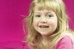 Cute Girl in Pink. A high key photo of a cute little girl smiling Stock Photography