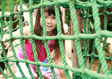 Cute girl in pink. Play in playground Stock Image