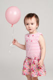 Cute girl with pink balloon Royalty Free Stock Photography