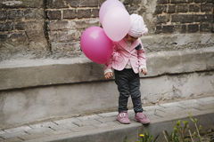 Cute girl with pink balloons portrait Stock Images