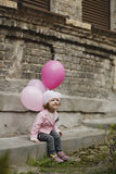 Cute girl with pink balloons portrait Royalty Free Stock Images