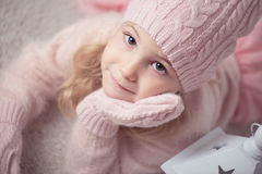 Cute girl in pink celebrating Christmas Royalty Free Stock Image