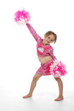 Cute girl in pink cheerleader outfit. Holding pompoms with one arm up in the air Stock Photography