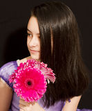 Cute girl with pink flowers. Shoot in studio royalty free stock images