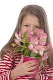 Cute girl with pink flowers. Cute girl at the age of five with pink flowers looking at the camera close-up on white Royalty Free Stock Photos