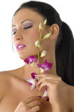 Cute girl and pink orchid Royalty Free Stock Images