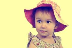 Cute girl with pink panama Stock Photo