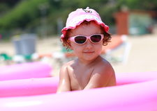 Cute girl in pink sunglasses Royalty Free Stock Images