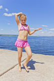 Cute girl in pink swimsuit royalty free stock photos