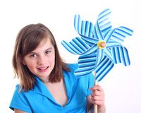 Cute girl with pinwheel. Stock Photos