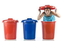 Cute girl in a plastic drum Stock Photography