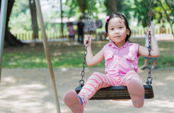 Cute girl play swing seat Royalty Free Stock Photos
