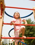 Cute girl on playground Stock Image