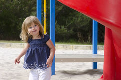 Cute girl on a playground Stock Photos