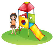 A cute girl at the playground Royalty Free Stock Photo