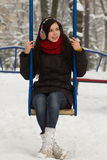 Cute girl on playground in winter Stock Photo