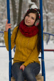 Cute girl on playground in winter Stock Images