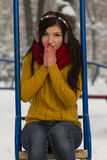 Cute girl on playground in winter Royalty Free Stock Photos