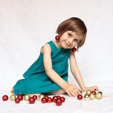Cute girl playin with christmas decorations Royalty Free Stock Image