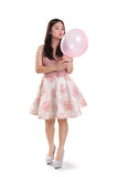 Cute girl playing with a balloon Stock Image
