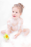 Cute girl playing in bath Stock Photography