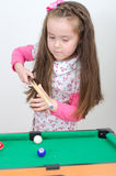 Cute girl playing billiard Stock Photo