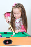 Cute girl playing billiard Royalty Free Stock Photo