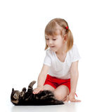 Cute girl playing with black kitten Stock Photos