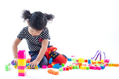A cute girl playing blocks toy on white background Royalty Free Stock Images