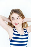 Cute girl playing with blond long hair standing. Near white wall and upwards hands stock photos