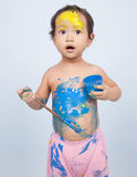 Cute girl playing with brush and paint Stock Photography