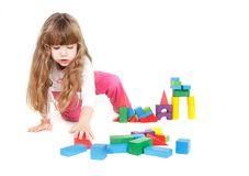 Cute girl playing with building blocks Royalty Free Stock Photo