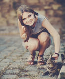 Cute girl playing with cat. Young smiley cute girl playing with cat at street Stock Photos