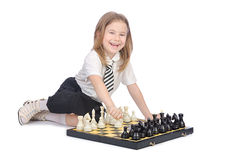 Cute girl playing chess Stock Images