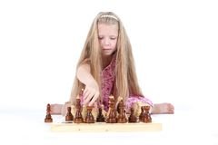 Cute girl playing chess on white Stock Photography