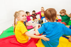 Cute girl playing circle games with friends in gym Stock Image