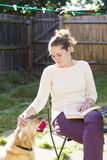 Cute girl playing with dog outdoor Royalty Free Stock Images