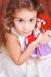 Cute girl playing with doll Royalty Free Stock Image
