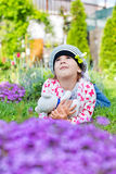 Cute girl playing in the flowers garden Stock Photo