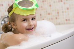 Cute girl playing in foam Royalty Free Stock Image