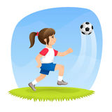 A cute girl playing football Royalty Free Stock Photos