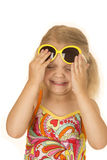 Cute girl playing with her sunglasses has her eyes closed Stock Photos