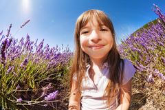Cute girl playing hide and seek in lavender field Stock Images