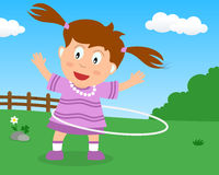 Cute Girl Playing with Hula Hoop in the Park Royalty Free Stock Image